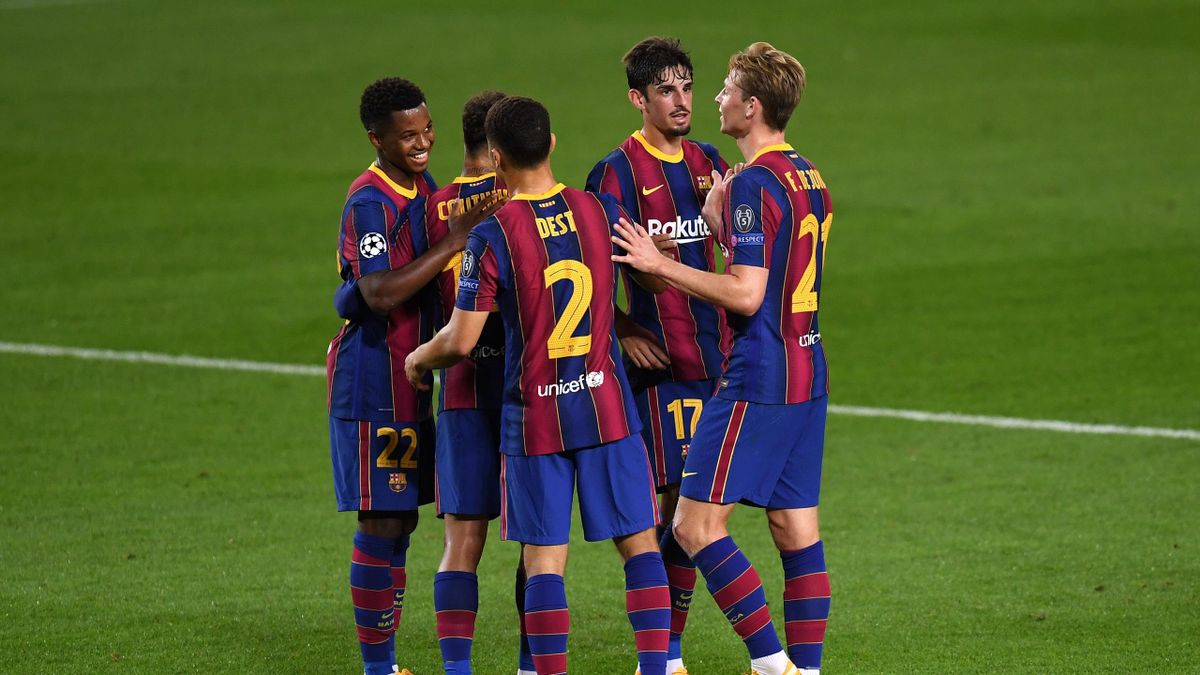Ansu Fati of FC Barcelona celebrates with teammates after scoring his sides second goal during the UEFA Champions League Group G stage match between FC Barcelona and Ferencvaros Budapest at Camp Nou on October 20, 2020 in Barcelona, Spain