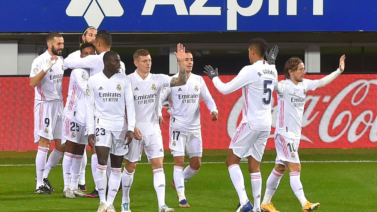 Real Madrid's French forward Karim Benzema (L) celebrates with teammates after scoring a goal during the Spanish league football match between SD Eibar and Real Madrid CF at the Ipurua stadium in Eibar on December 20, 2020.