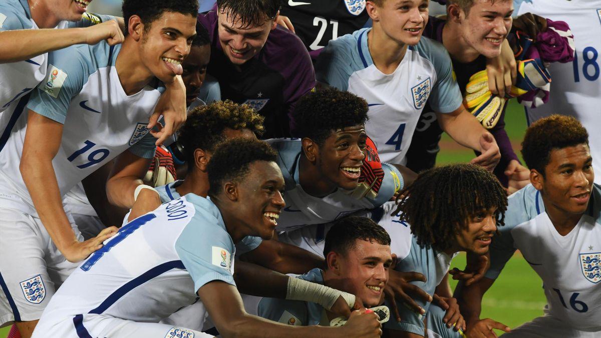 Members of the England team celebrate after winning the semifinal football match against Brazil in the FIFA U-17 World Cup at the Vivekananda Yuba Bharati Krirangan stadium in Kolkata on October 25, 2017