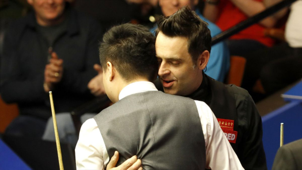 Ronnie O'Sullivan and Ding Junhui shared a warm embrace after China's top player reached the Crucible semi-finals