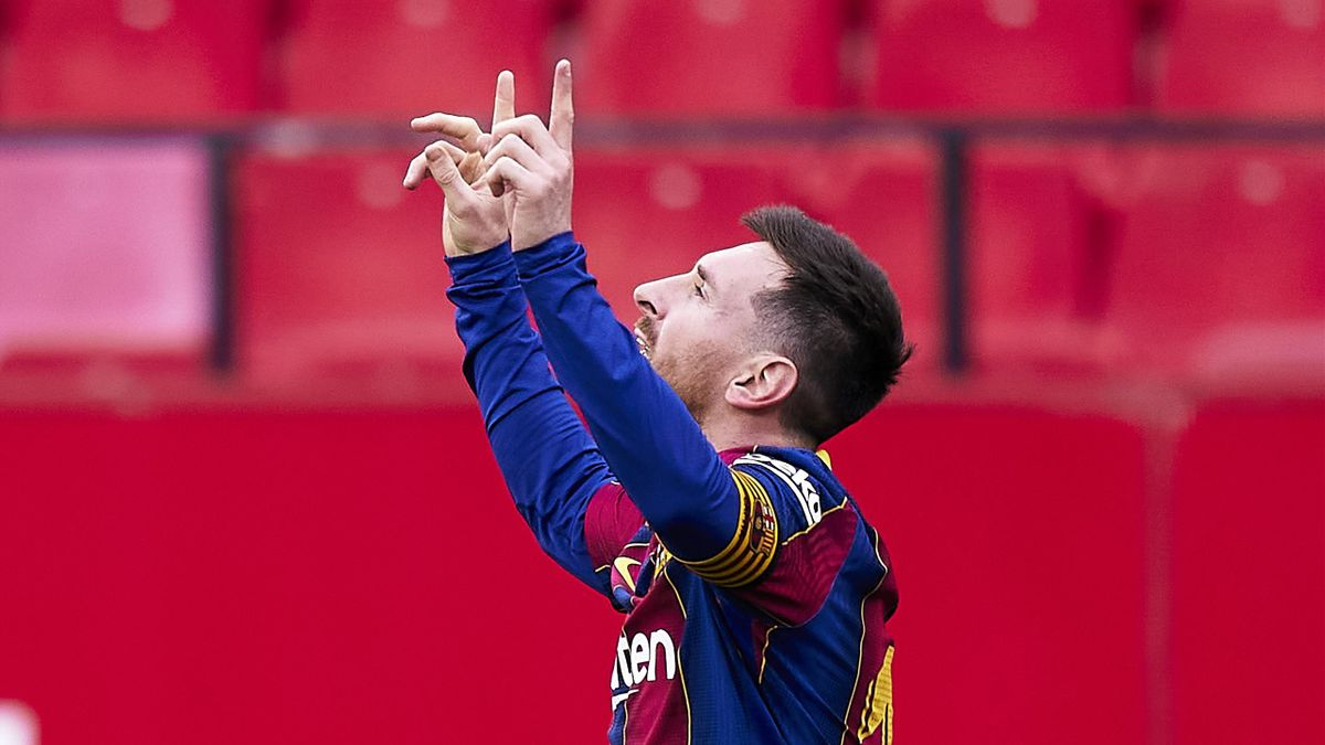 Lionel Messi of FC Barcelona celebrates his team's second goal during the La Liga Santander match between Sevilla FC and FC Barcelona at Estadio Ramon Sanchez Pizjuan on February 27, 2021 in Seville, Spain.