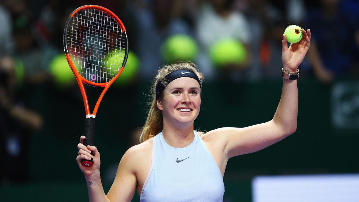 Elina Svitolina of Ukraine celebrates victory in her singles match against Simona Halep of Romania