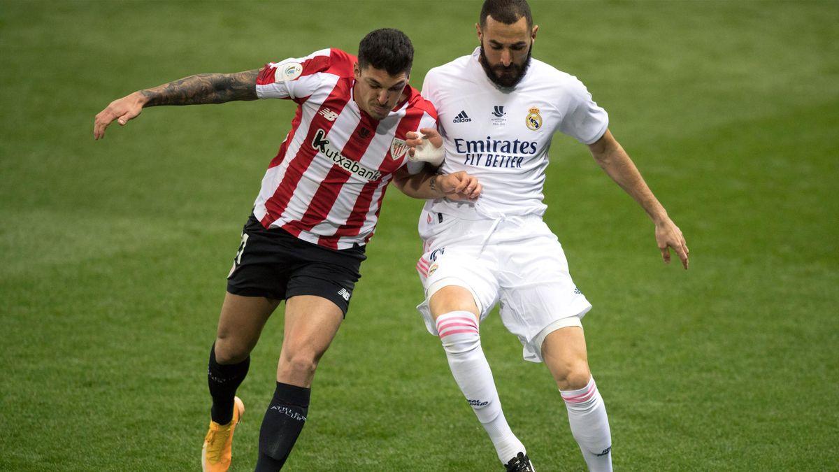 Athletic Bilbao's Ander Capa (L) vies with Real Madrid's Karim Benzema