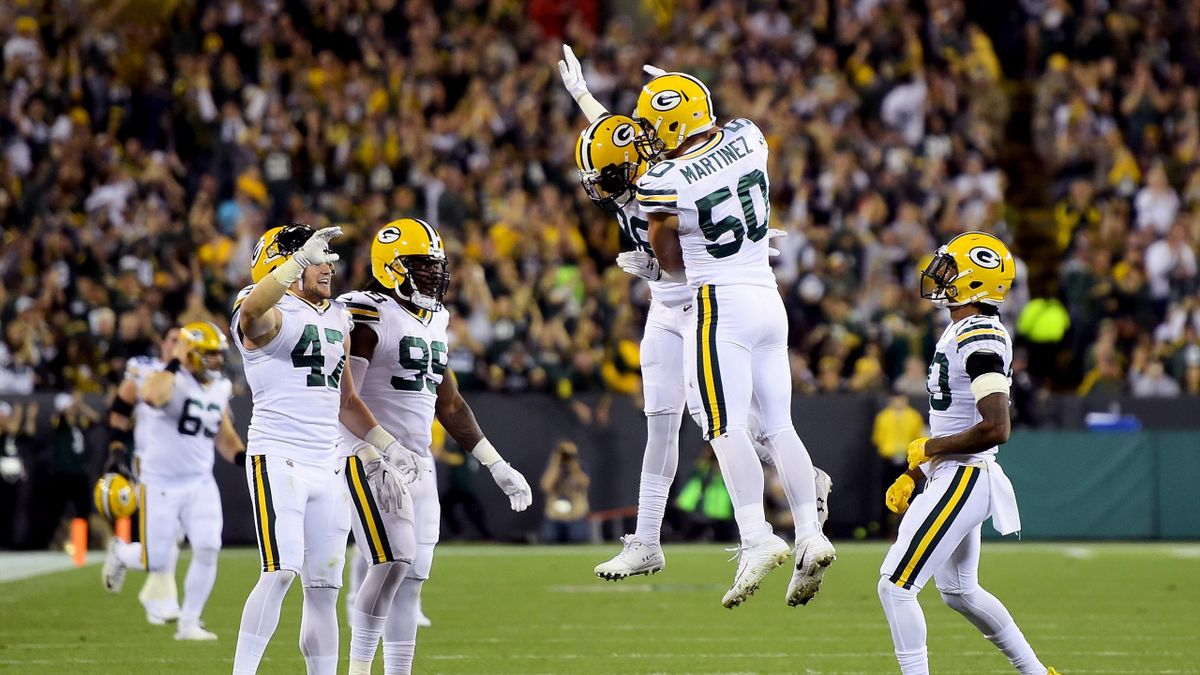Blake Martinez #50 of the Green Bay Packers celebrates with teammates after forcing a fumble in the first quarter against the Chicago Bears at Lambeau Field on September 28, 2017 in Green Bay, Wisconsin.