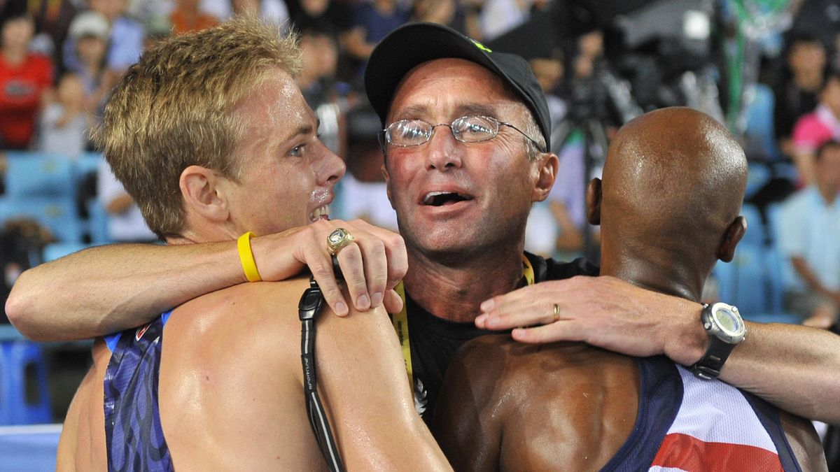 US coach Alberto Salazar (C) hugs Britain's Mo Farah (R) and US athlete Galen Rupp (L) following the men's 5,000 metres final at the International Association of Athletics Federations (IAAF) World Championships in Daegu on September 4, 2011