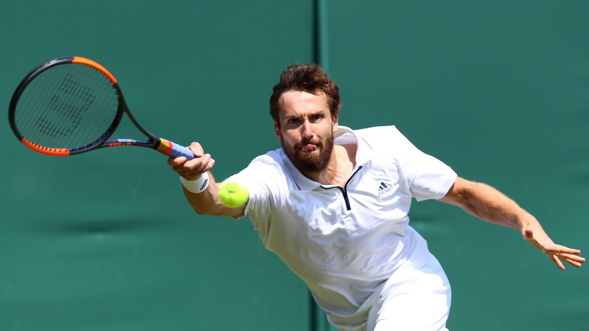 Ernests Gulbis of Latvia returns against Jay Clarke of Great Britain during their Men's Singles first round match on day two of the Wimbledon Lawn Tennis Championships at All England Lawn Tennis and Croquet Club on July 3, 2018 in London, England.