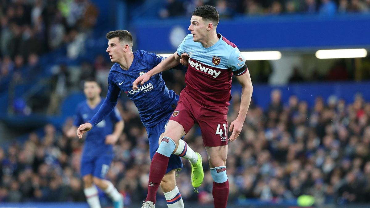 Mason Mount of Chelsea and Declan Rice of West Ham during the Premier League match between Chelsea FC and West Ham United at Stamford Bridge on November 30, 2019 in London, United Kingdom.