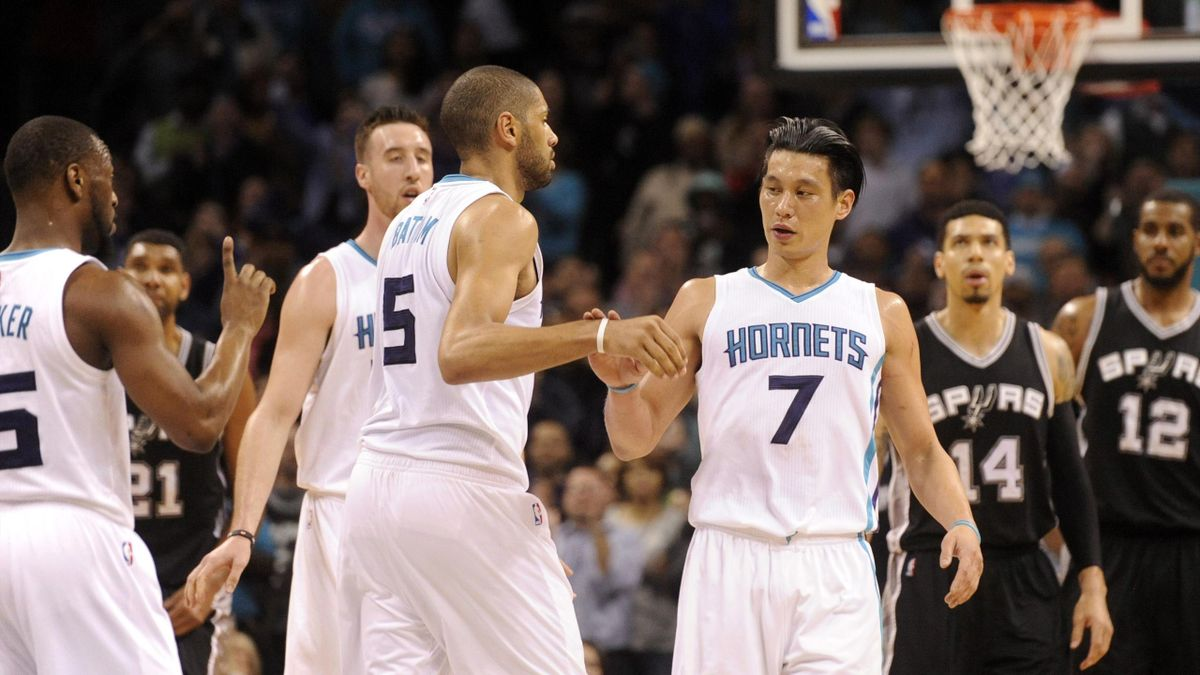 Charlotte Hornets guard Jeremy Lin (7) gets a congratulations from guard forward Nicolas Batum (5) and guard Kemba Walker (15) after scoring in the closing seconds of the game against the San Antonio Spurs at Time Warner Cable Arena