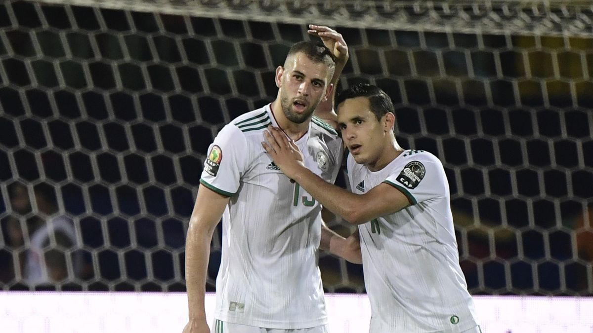 Islam Slimani is congratulated on his opener for Algeria