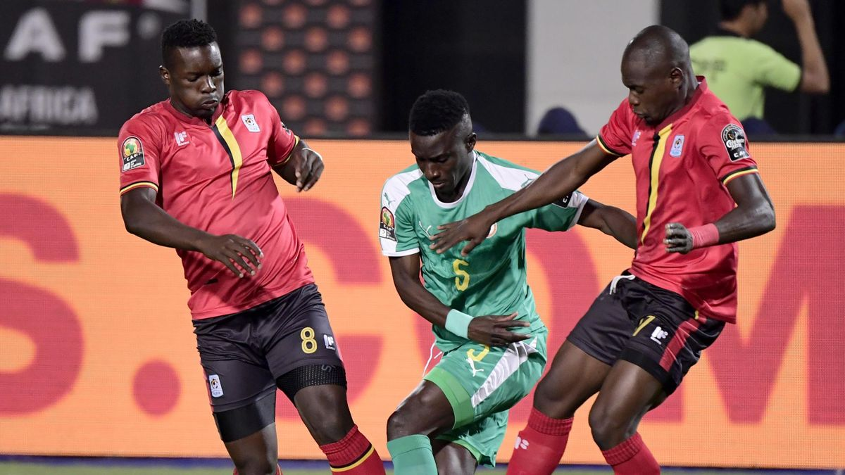 Senegal's midfielder Idrissa Gueye (C) fights for the ball against Uganda's midfielder Khalid Aucho (L) and Uganda's forward Emmanuel Okwi during the 2019 Africa Cup of Nations (CAN) Round of 16 football match between Uganda and Senegal at the Cairo Inter