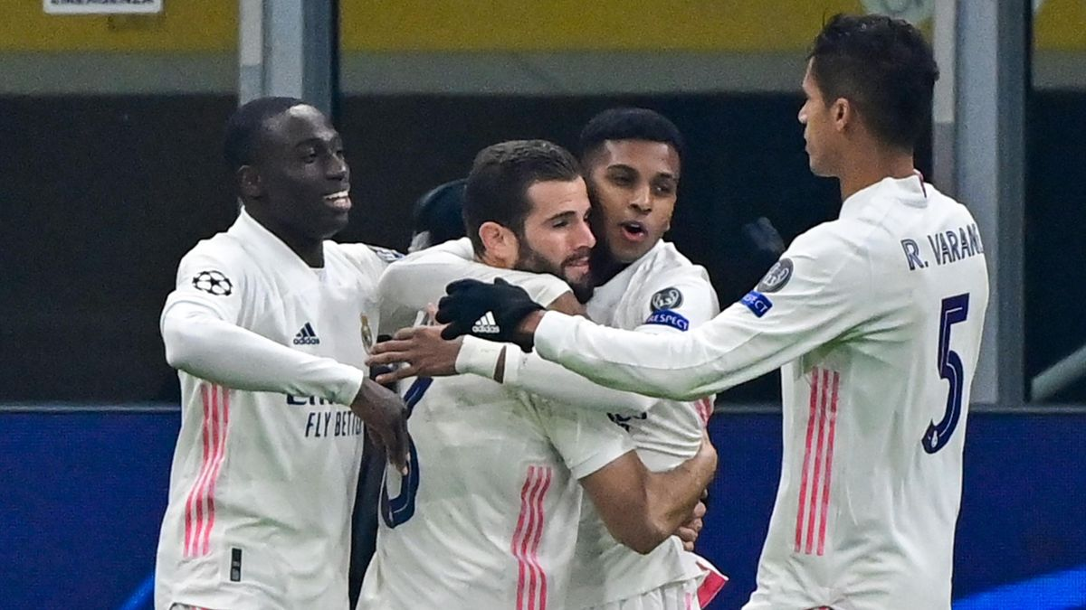 Real Madrid's Brazilian forward Rodrygo (2ndR) celebrates with (From L) Real Madrid's French defender Ferland Mendy, Real Madrid's Spanish defender Nacho Fernandez and Real Madrid's French defender Raphael Varane after scoring during the UEFA Champions Le