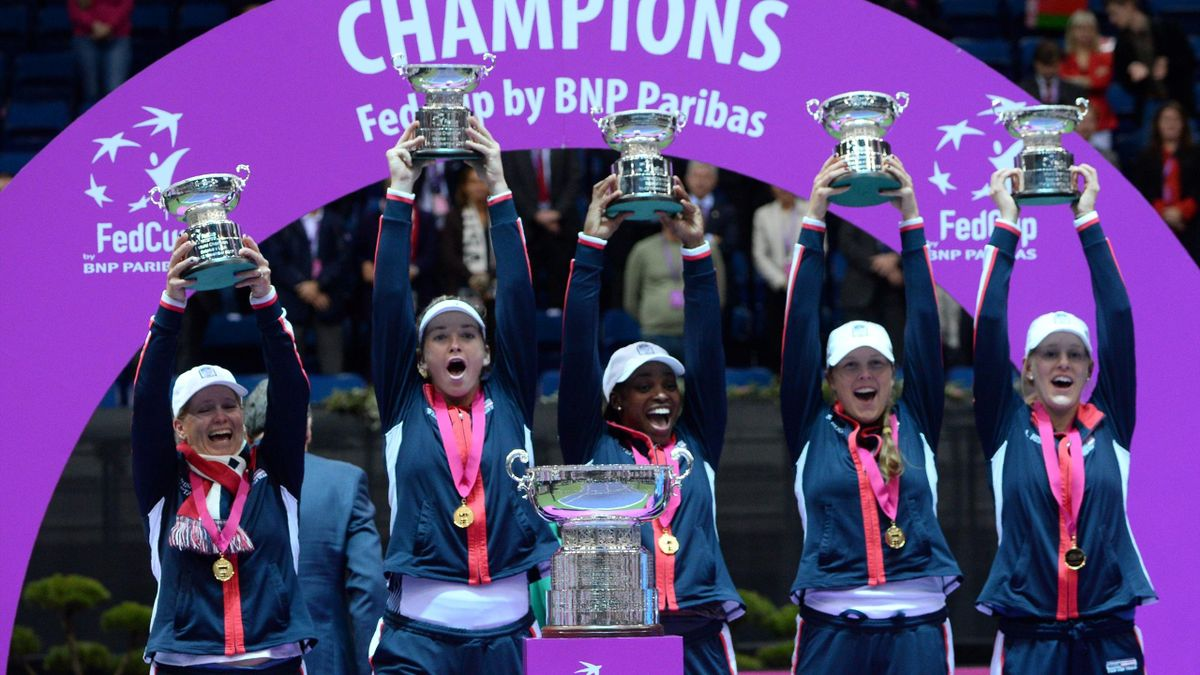 US team celebrate with their trophy after winning the Fed Cup final tennis match between Belarus and the United States, on November 12, 2017 in Minsk.