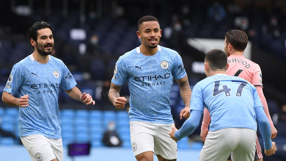 Manchester City's Brazilian striker Gabriel Jesus (C) celebrates scoring the opening goal during the English Premier League football match between Manchester City and Sheffield United at the Etihad Stadium
