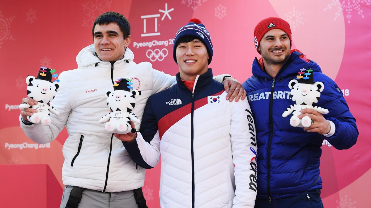 Silver medalist Nikita Tregubov of Olympic Athlete from Russia, gold medalist Sungbin Yun of Korea and bronze medalist Dom Parsons of Great Britain celebrate following the Men's Skeleton at Olympic Sliding Centre on February 16, 2018 in Pyeongchang-gun, S