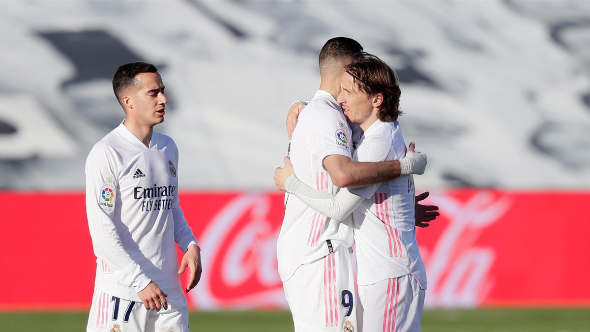 Karim Benzema of Real Madrid Celebrates 1-1 with Luka Modric of Real Madrid , Lucas Vazquez of Real Madrid during the La Liga Santander match between Real Madrid v Elche at the Estadio Alfredo Di Stefano on March 13, 2021 in Madrid Spain