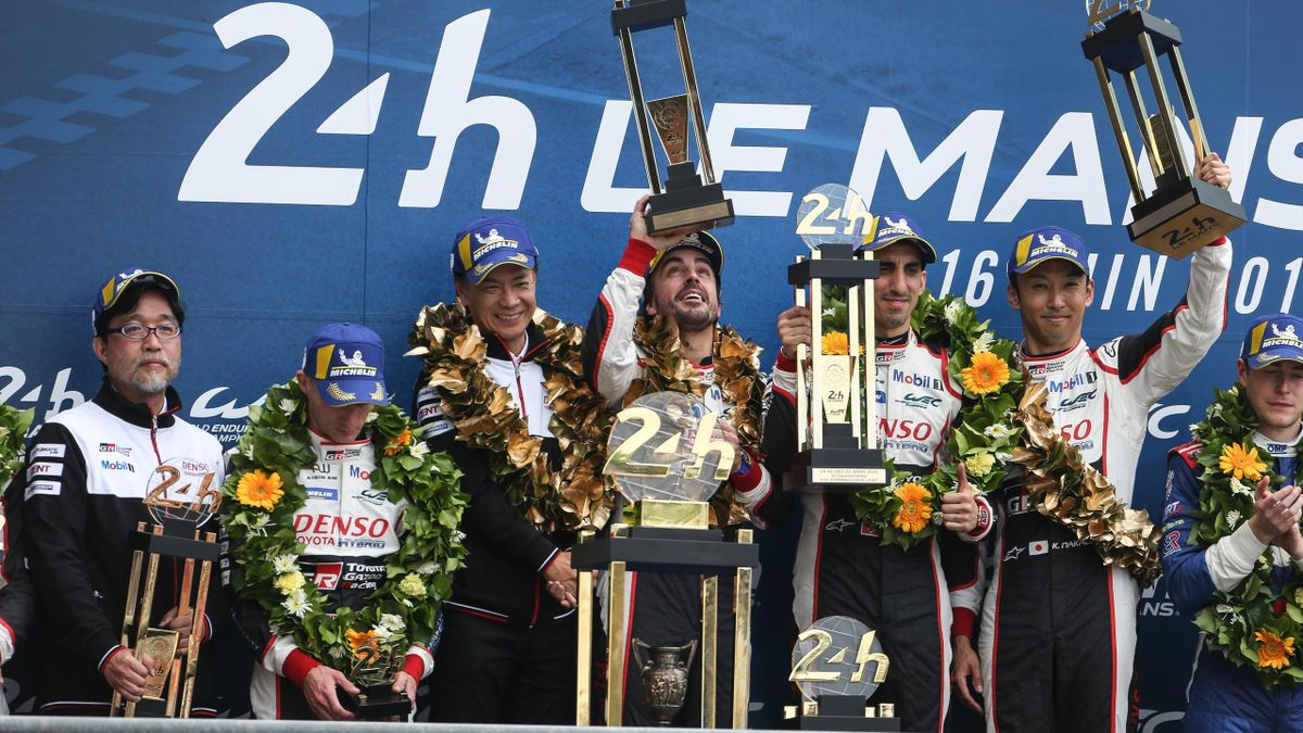 Race winners Fernando Alonso of Spain and Toyota Gazoo Racing, Sebastien Buemi of Switzerland and Toyota Gazoo Racing and Kazuki Nakajima of Japan and Toyota Gazoo Racing celebrate on the podium during the 24 Hours of Le Mans on June 16, 2019