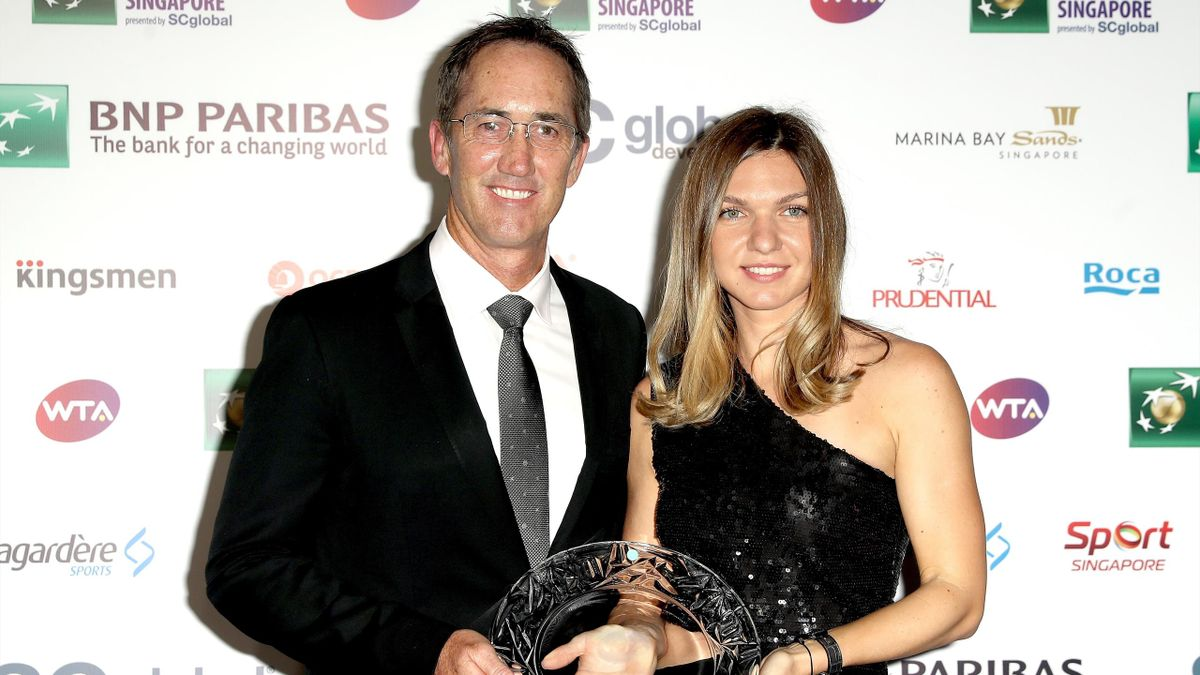 Coach Darren Cahill and Simona Halep of Romania pose with her Player of the Year award during the Official Draw Ceremony and Gala of the BNP Paribas WTA Finals Singapore presented by SC Global at Marina Bay Sands Hotel on October 19, 2018 in Singapore.