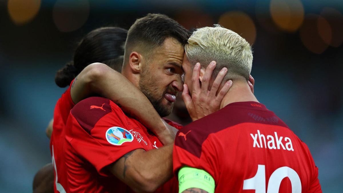Haris Seferovic of Switzerland celebrates with teammate Granit Xhaka