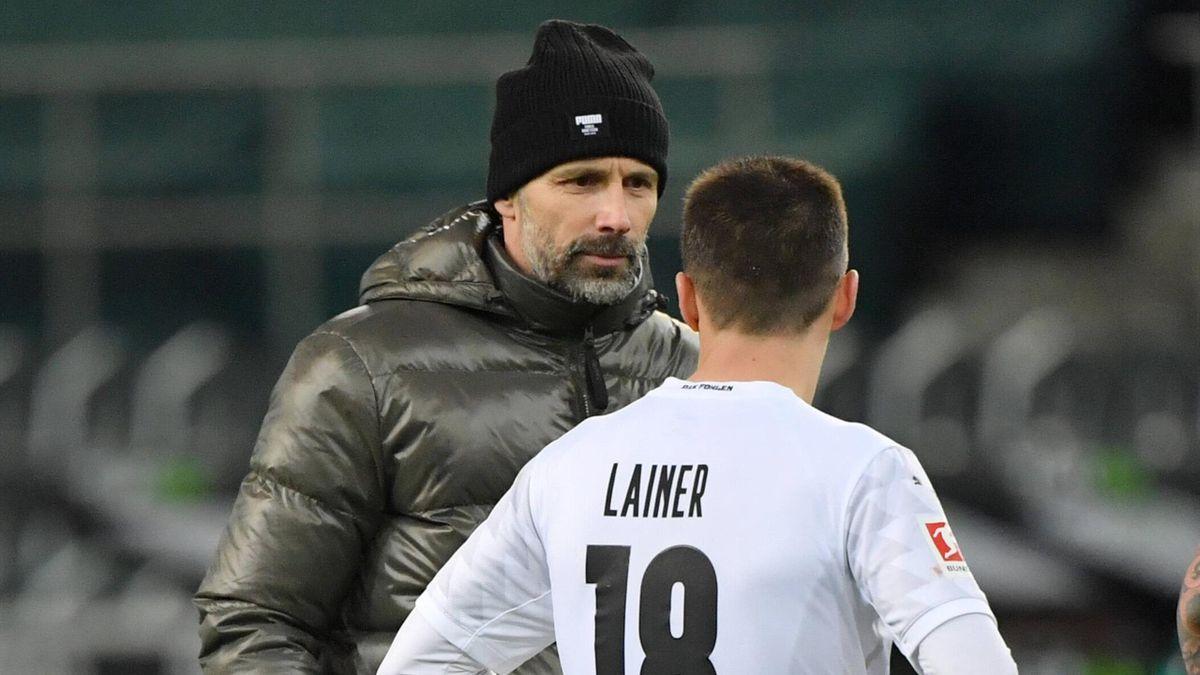Marco Rose (links) im Stefan Lainer - Borussia Mönchengladbac