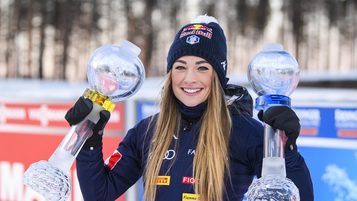 Dorothea Wierer of Italy with the globe of the total score and mass start score during the Women 10 km Pursuit Competition at the BMW IBU World Cup Biathlon Kontiolahti at on March 14, 2020 in Kontiolahti, Finland