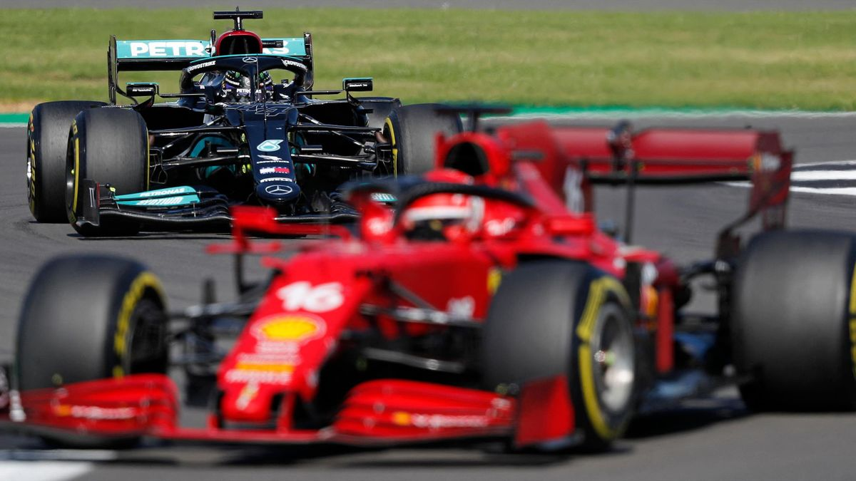 Mercedes' British driver Lewis Hamilton (L) and Ferrari's Monegasque driver Charles Leclerc (R) drive during the Formula One British Grand Prix motor race at Silverstone motor racing circuit in Silverstone, central England on July 18, 2021.