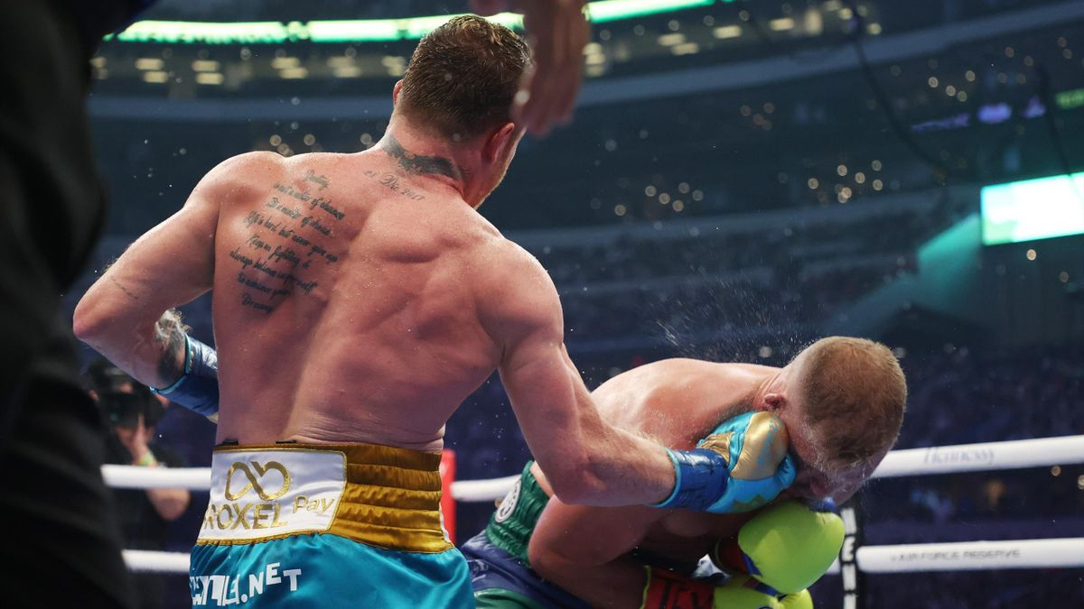 Saul Canelo Alvarez punches Billy Joe Saunders, super middleweight title fight, at AT&T Stadium, Arlington, Texas, on May 08, 2021