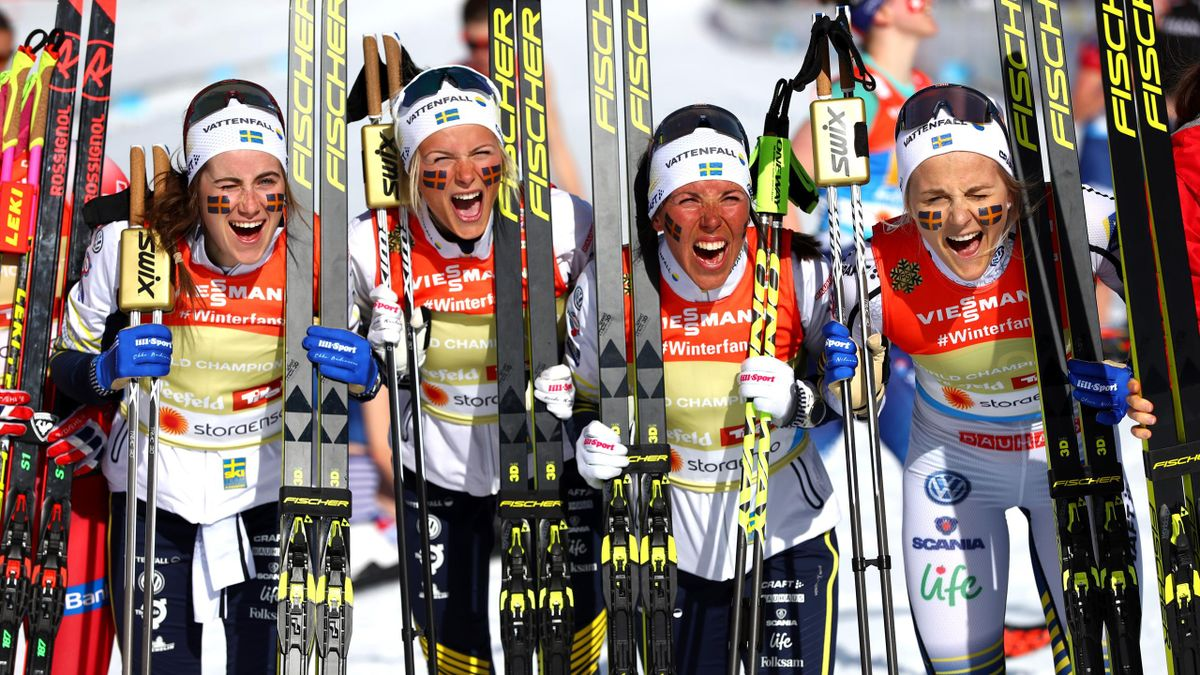 Ebba Andersson, Frida Karlsson, Charlotte Kalla and Stina Nilsson of Sweden celebrate victory during the Women's 4x5km Cross Country Relay at the FIS Nordic World Ski Championships on February 28, 2019 in Seefeld, Austria.