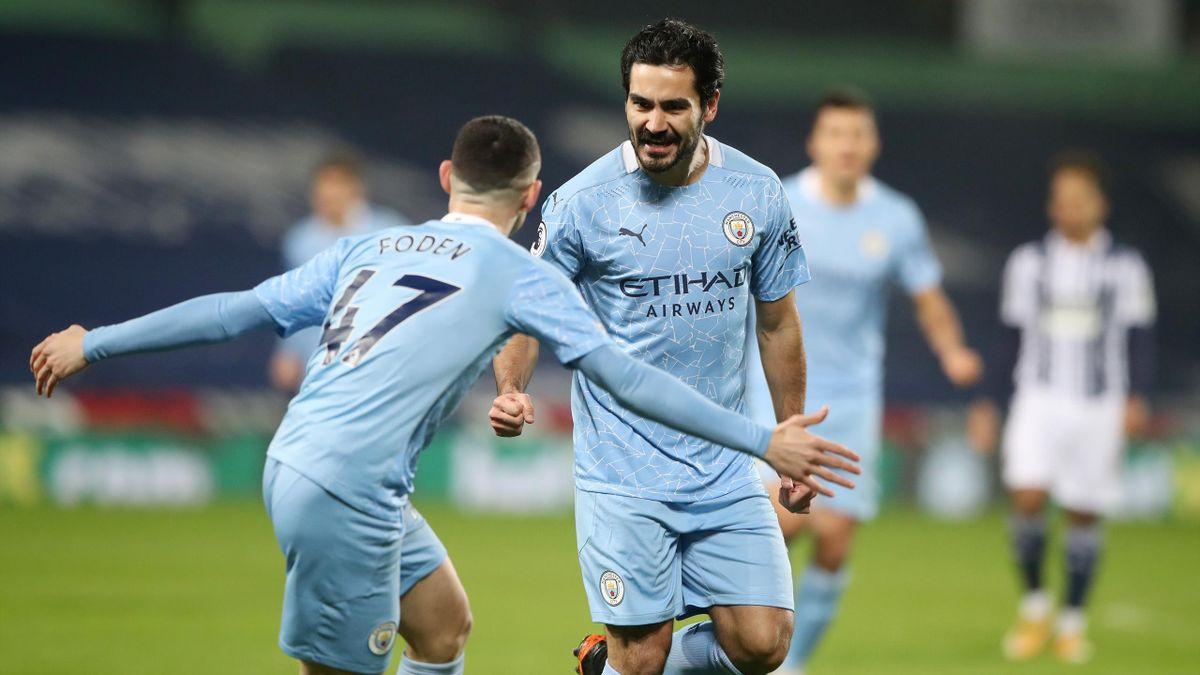 Ilkay Gündogan (rechts; Manchester City) jubelt mit Teamkollege Phil Foden