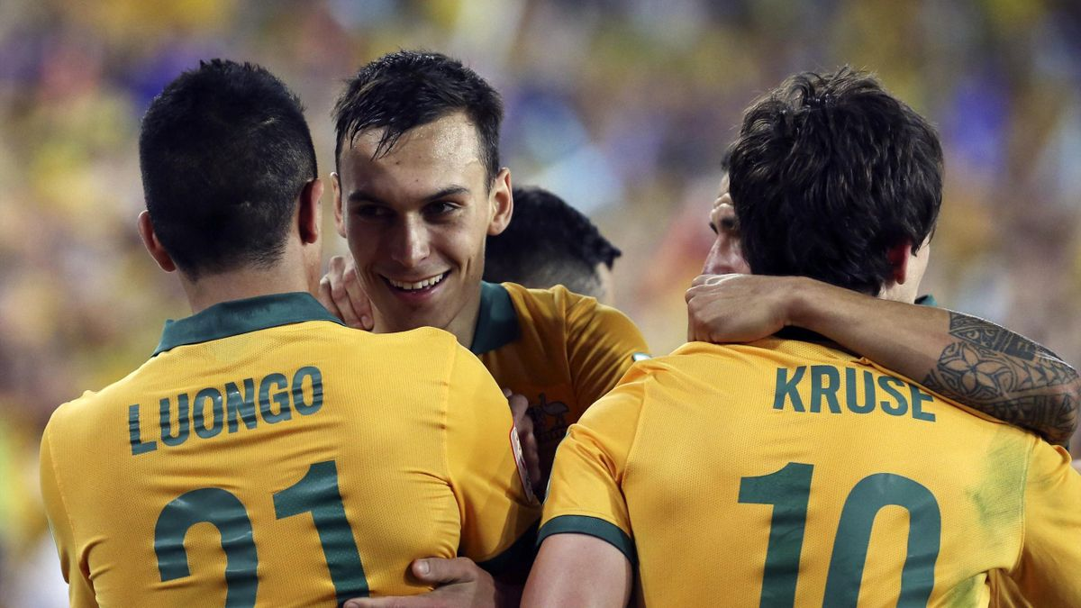 Australia's Massimo Luongo (L) celebrates with teammates Trent Sainsbury (2nd L), Tim Cahill and Robbie Kruse (R) after scoring a goal against South Korea during their Asian Cup final soccer match at the Stadium Australia in Sydney (Reuters)