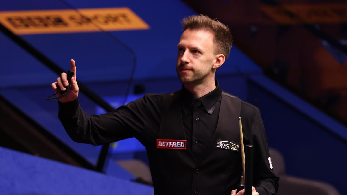 Judd Trump of England celebrates victory following the Betfred World Snooker Championship Round Two match between David Gilbert of England and Judd Trump of England at Crucible Theatre