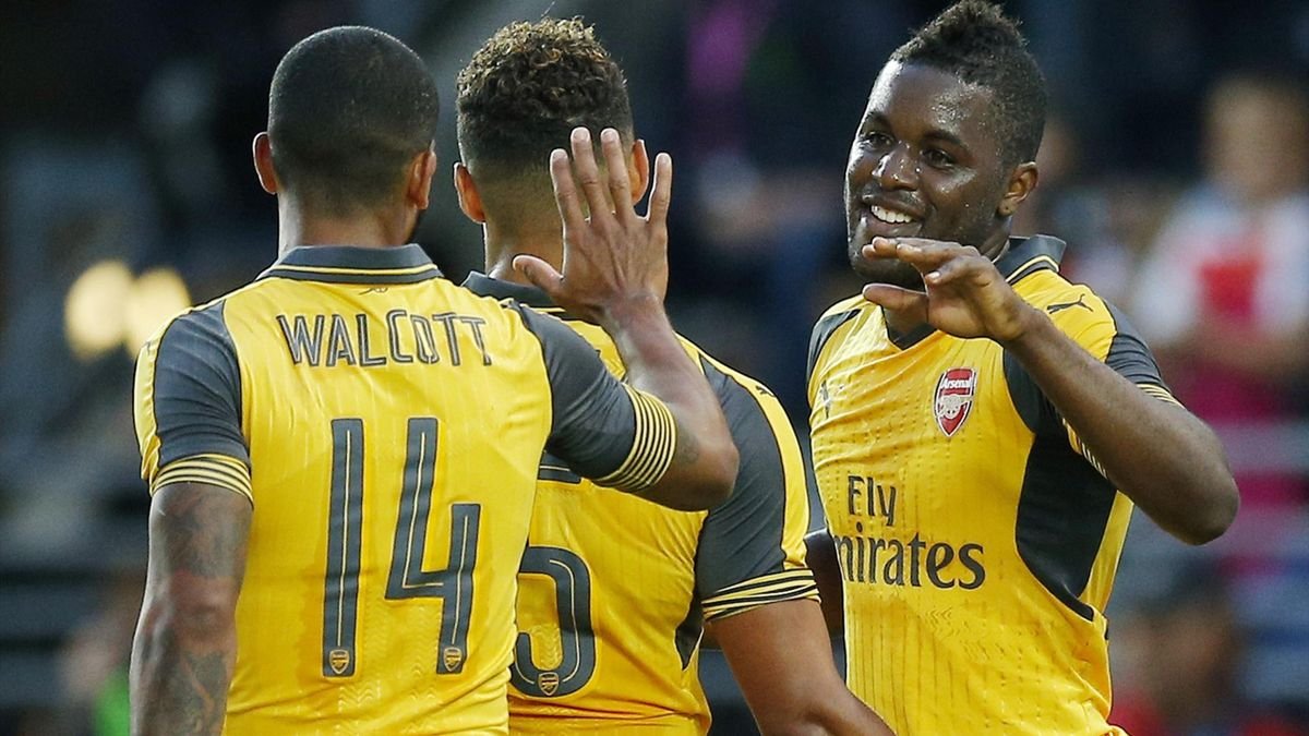 Arsenal's Joel Campbell celebrates scoring their first goal with Alex Oxlade Chamberlain and Theo Walcott
