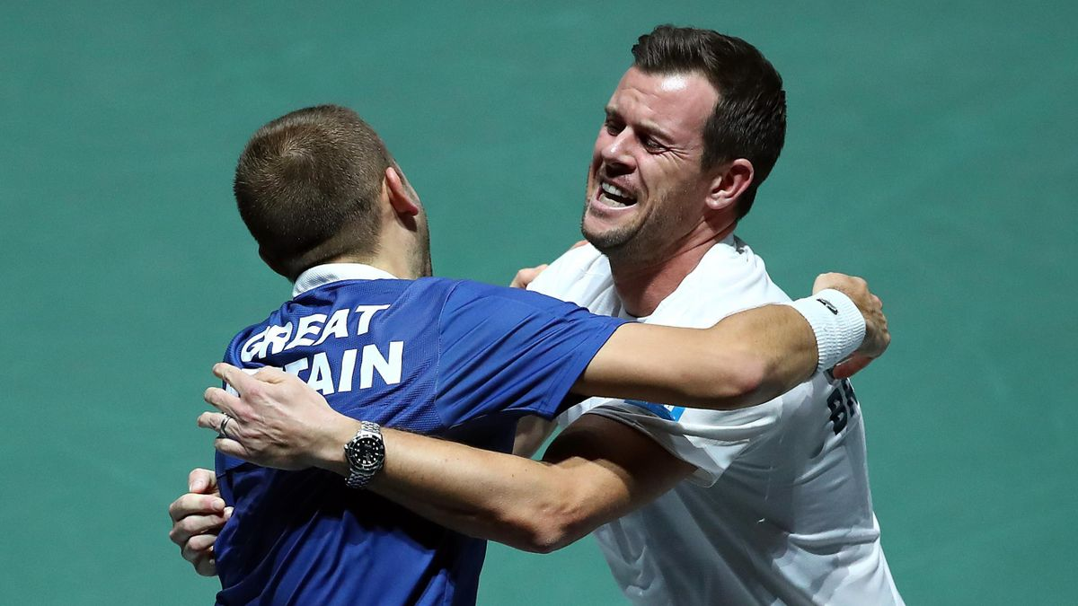 Dan Evans and Leon Smith embrace after GB's win over Germany at the Davis Cup