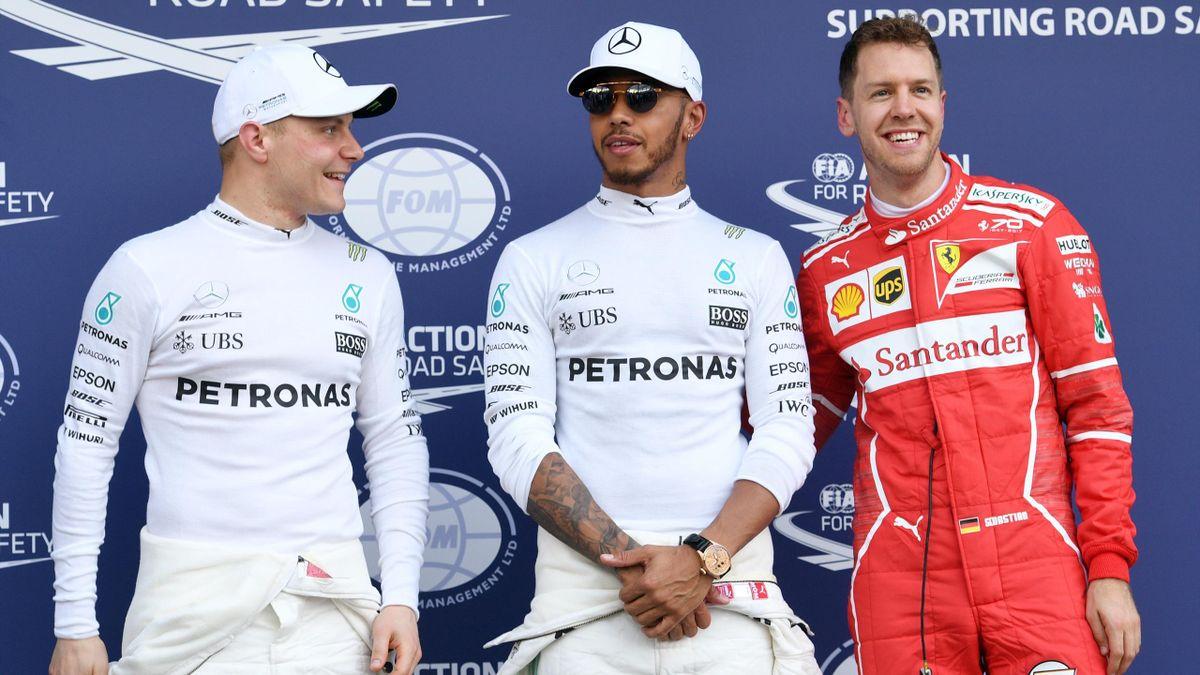 Mercedes' British driver Lewis Hamilton (C), teammate Mercedes' Finnish driver Valtteri Bottas (L) and Ferrari's German driver Sebastian Vettel (R)