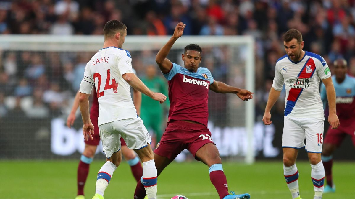 Sebastien Haller of West Ham United is challenged by Gary Cahill of Crystal Palace during the Premier League match between West Ham United and Crystal Palace at London Stadium on October 05, 2019 in London, United Kingdom.