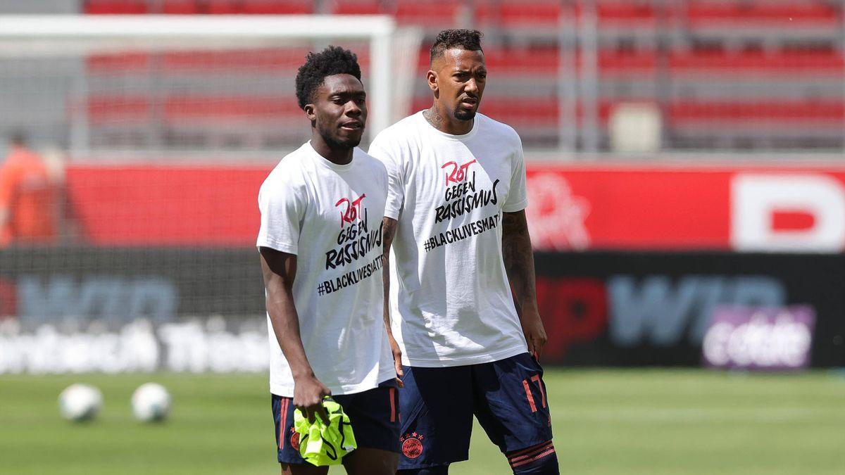 Alphonso Davies und Jérôme Boateng vom FC Bayern München