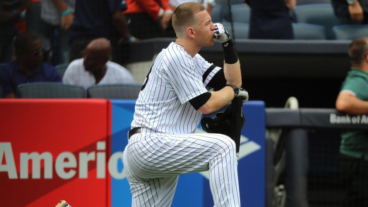 Todd Frazier #29 of the New York Yankees reacts after a child was hit by a foul ball off his bat in the fifth inning against the Minnesota Twins on September 20, 2017 at Yankee Stadium in the Bronx borough of New York City.