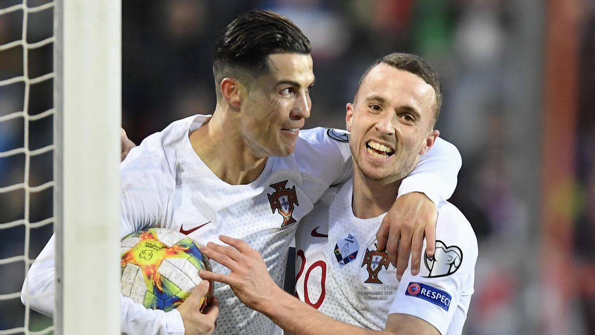Portugal's forward Cristiano Ronaldo (L) celebrates after scoring a goal during the UEFA Euro 2020 Group B qualification football match between Luxembourg and Portugal