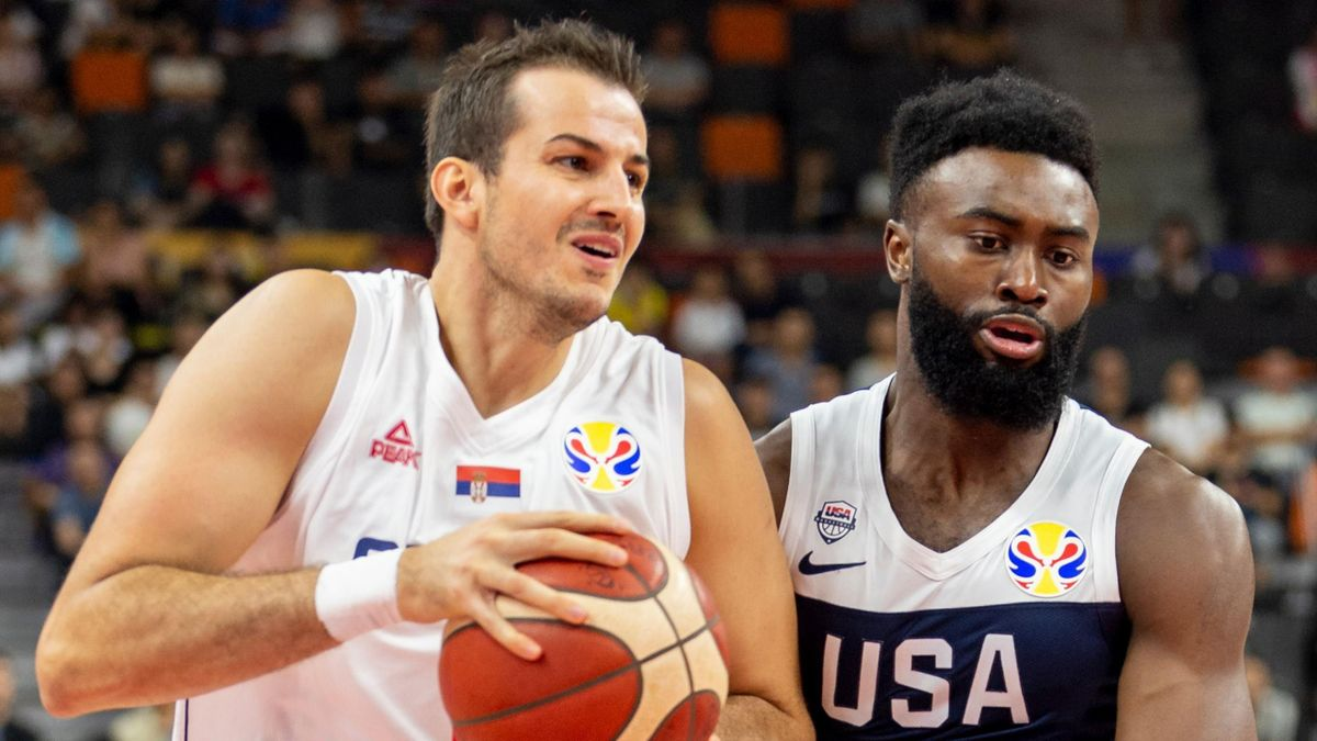 Nemanja Bjelica of Serbia (L) controls the ball as Jaylen Brown of the US (R) defends during the Basketball World Cup