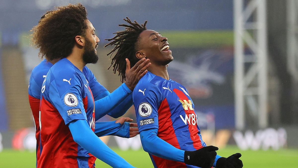 Crystal Palace's English midfielder Eberechi Eze (R) celebrates scoring the opening goal during the English Premier League football match between Crystal Palace and Wolverhampton Wanderers at Selhurst Park in south London on January 30, 2021