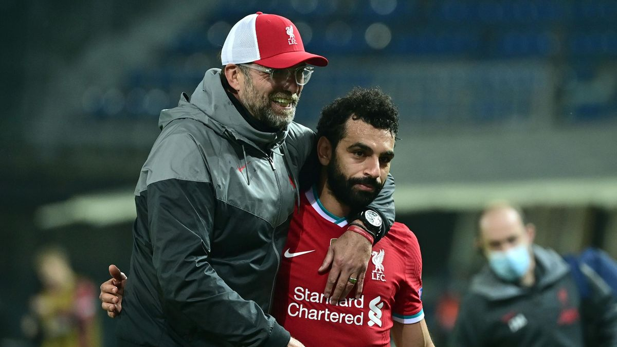 Jurgen Klopp (L) and Mohamed Salah (R)