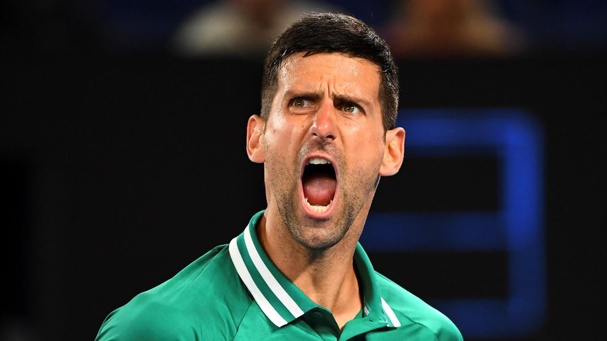 Serbia's Novak Djokovic reacts on a point against Taylor Fritz of the US during their men's singles match on day five of the Australian Open tennis tournament in Melbourne