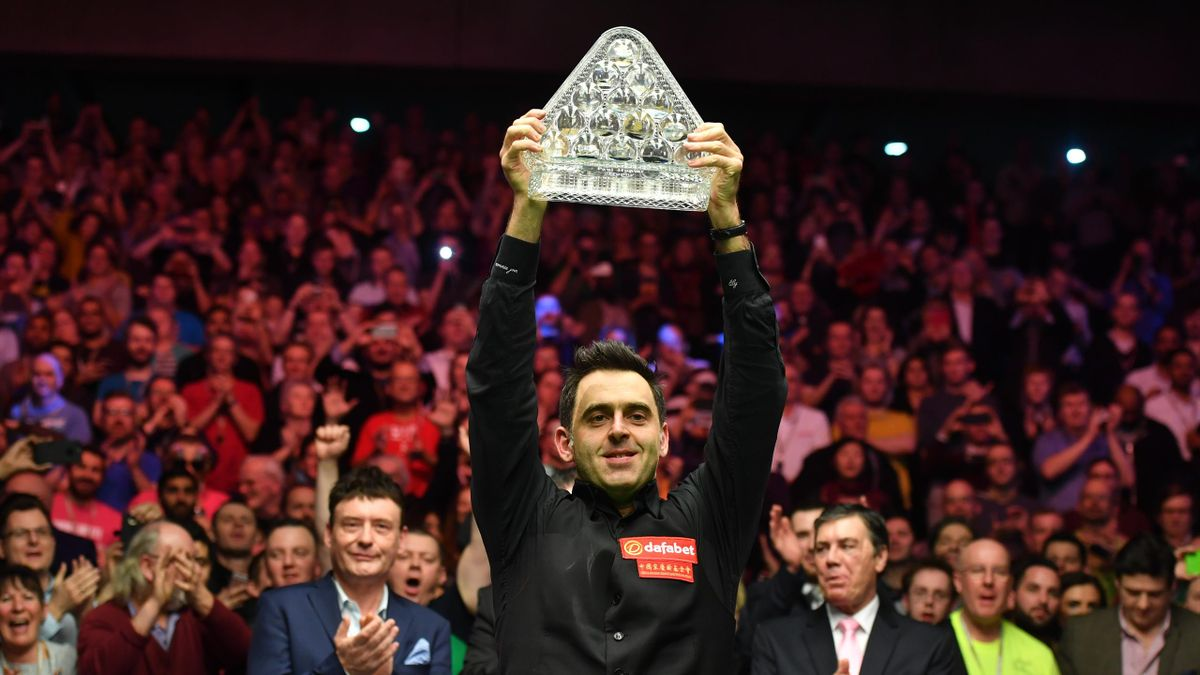 England's Ronnie O'Sullivan poses with the Paul Hunter Trophy after beating England's Joe Perry in the final to win the Masters snooker tournament at Alexandra Palace in London, on January 22, 2017.