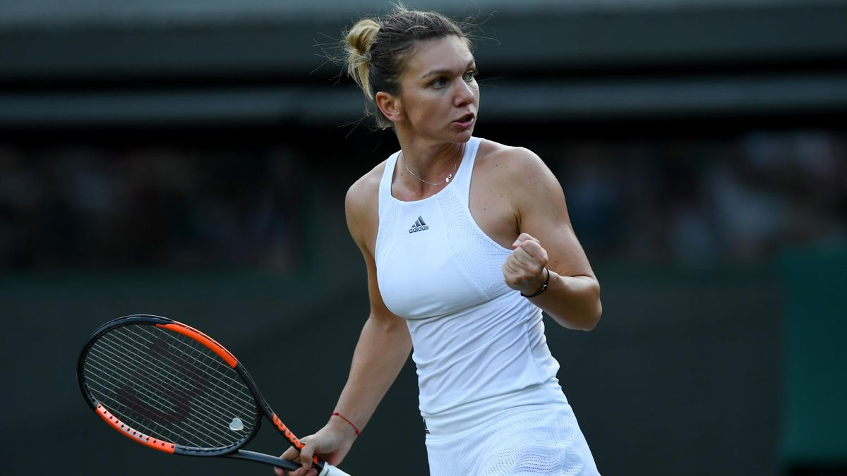 Simona Halep of Romania celebrates victory at Wimbledon