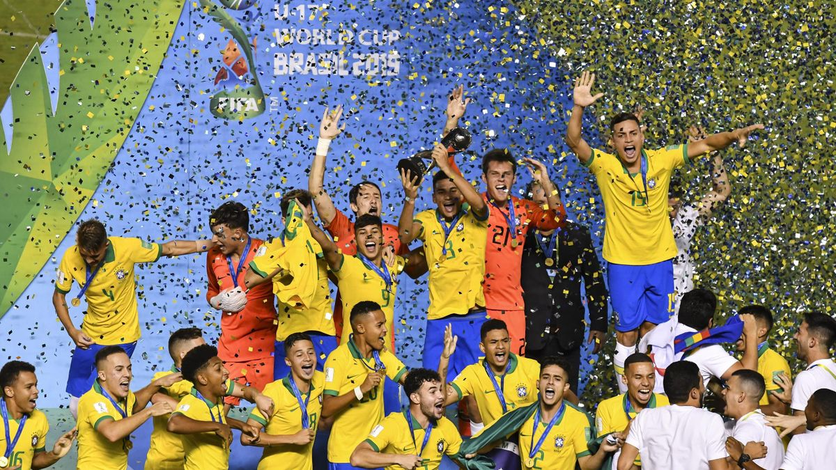 Brazil players celebrate with the World Cup Trophy after winning the final of the FIFA U-17 Men's World Cup Brazil 2019