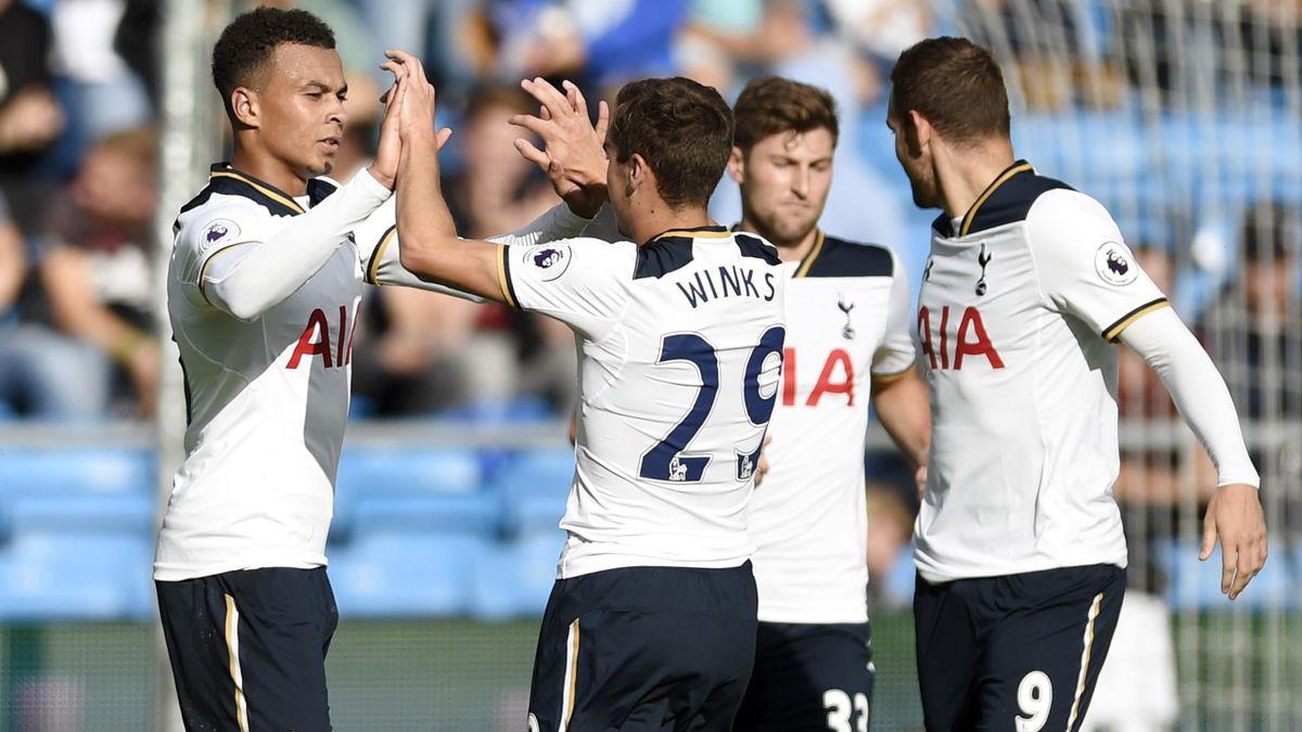 Tottenham players celebrate a goal against Inter Milan