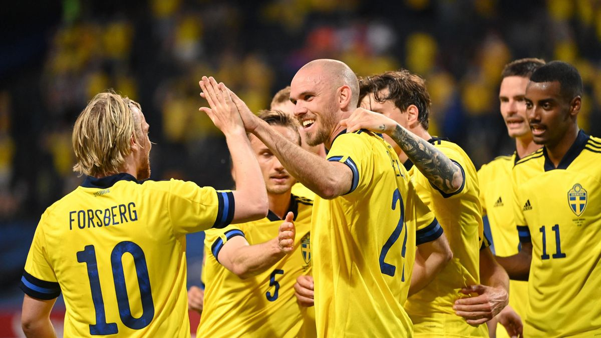Marcus Danielson (C) celebrates with teammates scoring during the friendly football match Sweden vs Armenia