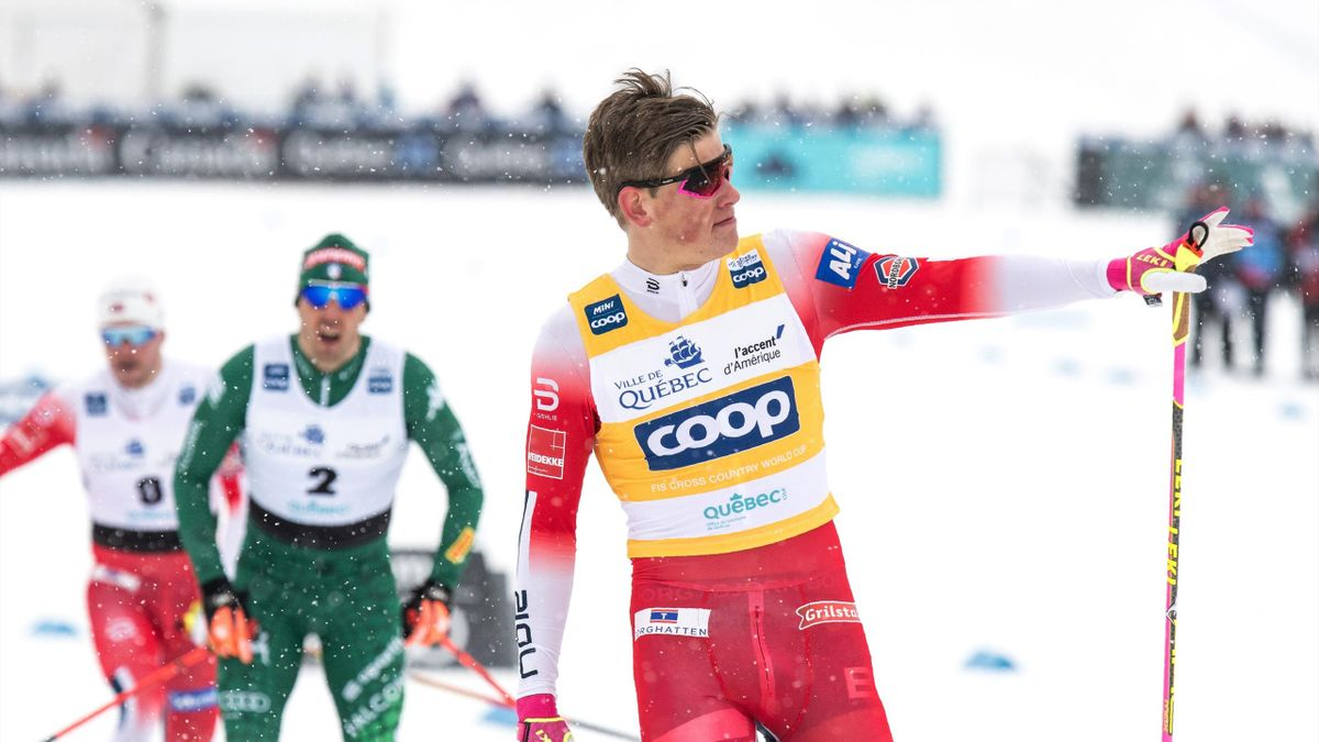 Norwegian skier Johannes Hoesflot Klaebo (R) crosses the finish line in the men's sprint finale on March 22, 2019 on the first day of the FIS cross-country world cup finals in Quebec City, Canada