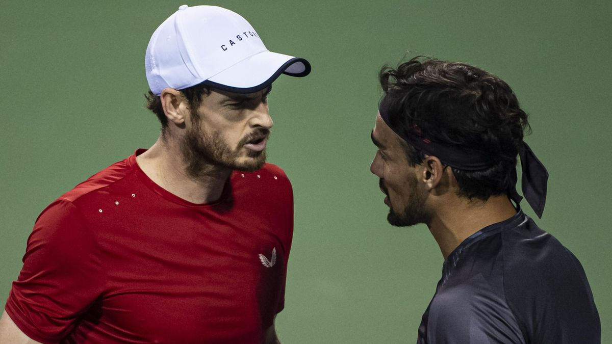 Andy Murray of Great Britain speaking to Fabio Fognini of Italy after his loss in the second round of the Shanghai Rolex Masters at the Qi Zhong Tennis Centre on October 08