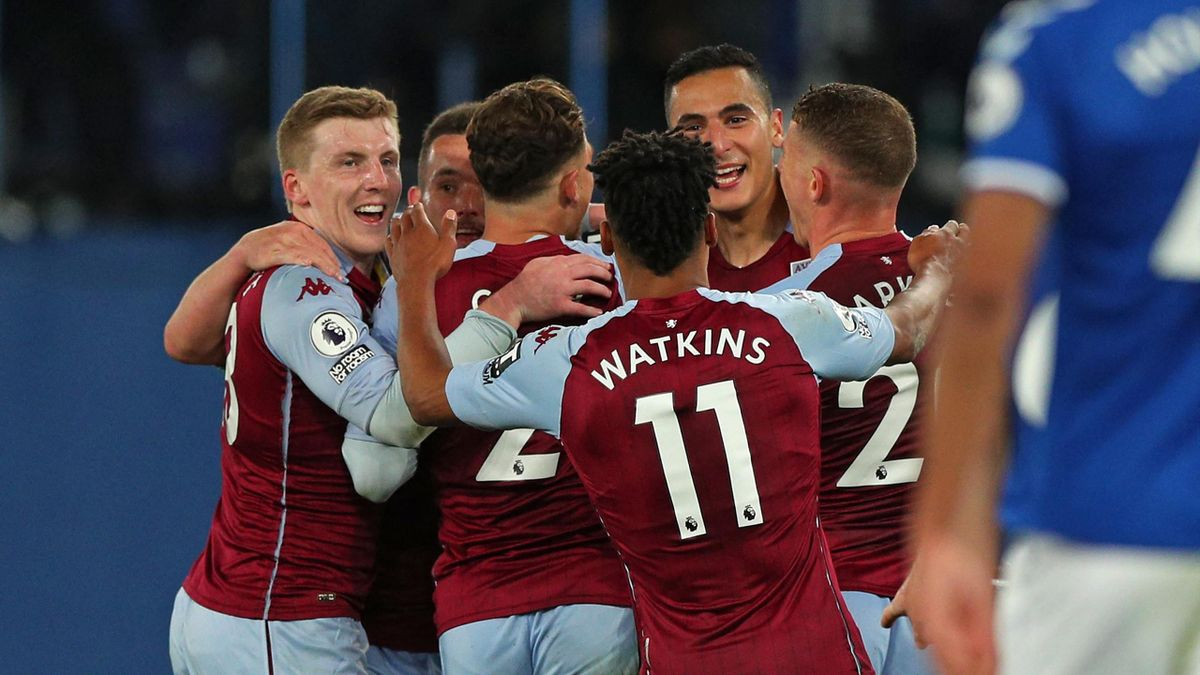 Aston Villa's Dutch striker Anwar El Ghazi (C) celebrates with teammates after scoring their second goal during the English Premier League football match between Everton and Aston Villa at Goodison Park in Liverpool, north west England on May 1, 2021.