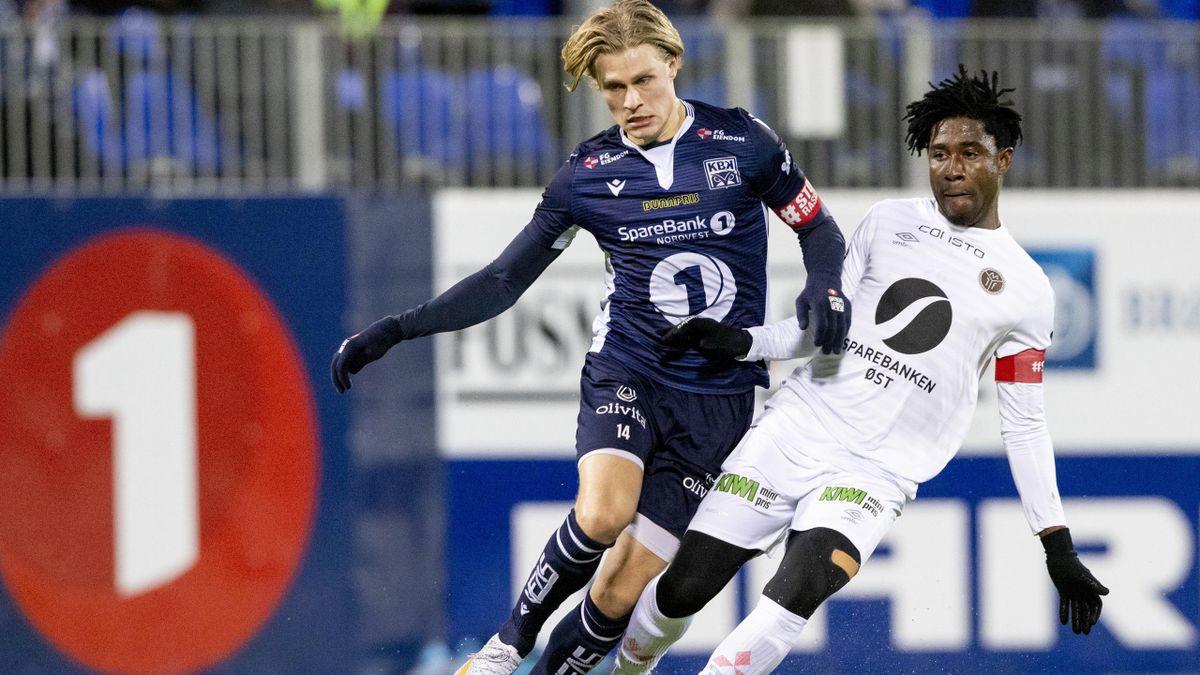 KBK-spiller Olaus Skarsem (tv) i duell med Mjøndalens Isaac Twum.